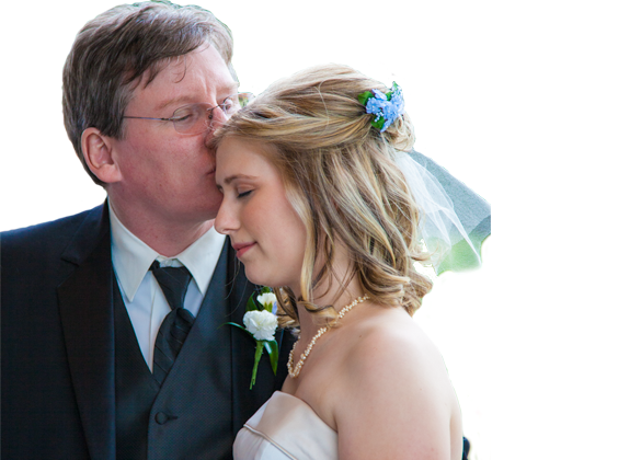 Father kisses Daughter at her wedding