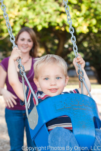 Child in swing, portrait from Photos by Orion