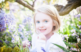 Child's specialty portrait at Bush Pasture Park under blooming tree