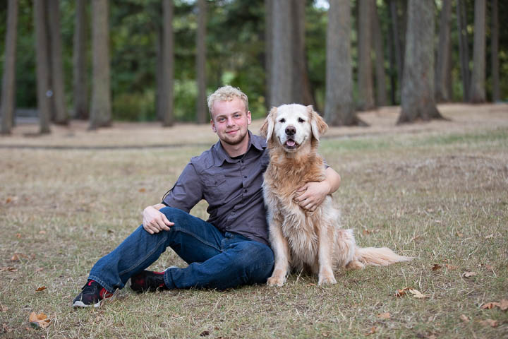 Senior portrait with his golden retriever